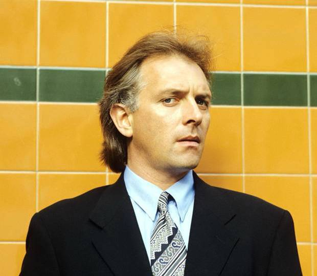 Rik Mayall dead: 'We don't know what killed him yet,' says wife